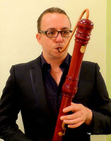 Photo of Dan Murphy playing recorder